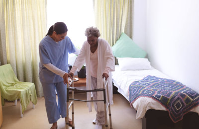 caregiver taking care of her patient