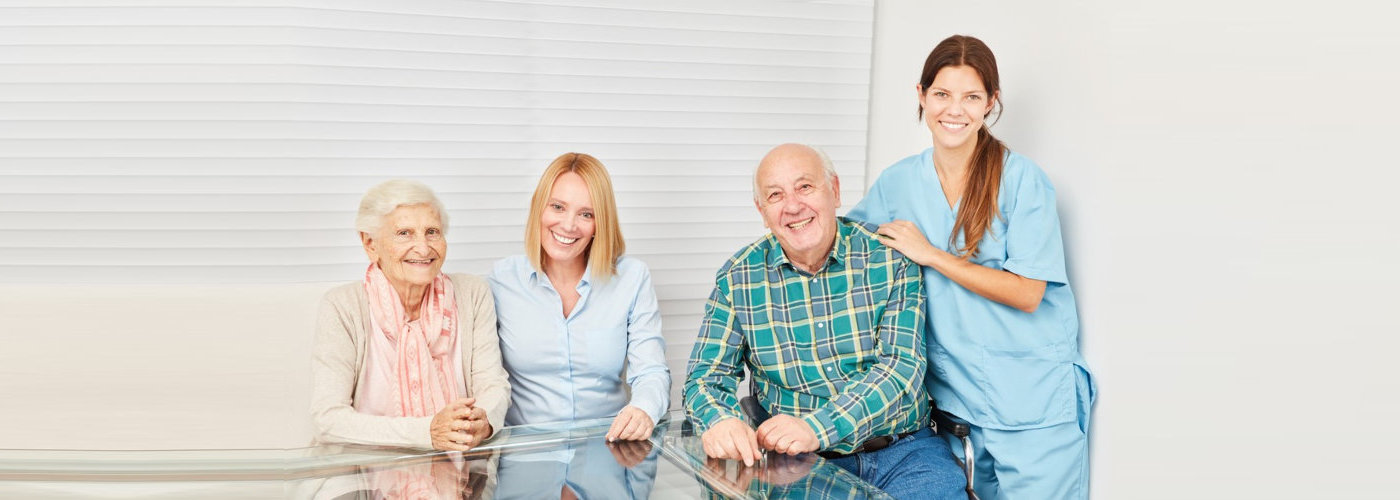 caregiver along with their patients smiling