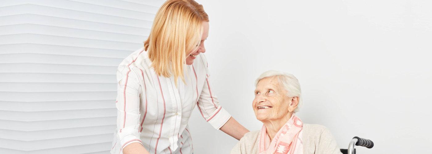 caregiver serving her patient her meal